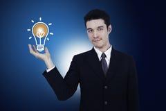 Business man holding light bulb Royalty Free Stock Image