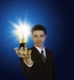 Business man holding light bulb Stock Photos