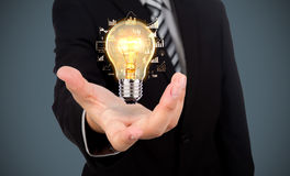 Business man holding light bulb Royalty Free Stock Photography