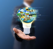 Business man holding light bulb Royalty Free Stock Images