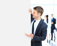 Business man holding a long blank Royalty Free Stock Photo