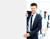 Business man holding a long blank banner Stock Photo