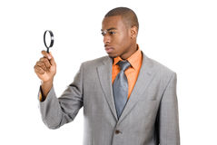 Business man holding magnifying glass Royalty Free Stock Image