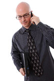 Business Man Holding Mobile Phone and Laptop Stock Photos
