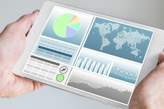 Business man holding modern tablet with both hands with business dashboard Stock Images
