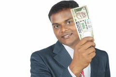 Business man holding money Royalty Free Stock Images
