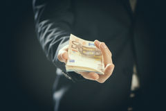 Business man holding money in hand Stock Photo