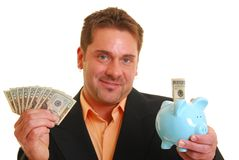 Business man holding a money and a piggy bank Stock Photos