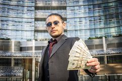 Business man holding money Royalty Free Stock Photo
