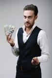 Business man holding money Stock Photo