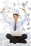 Business man holding money  and raising hands. With money rain Stock Image