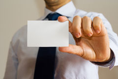 Business man holding a name card. Business man holding a blank name card Stock Images