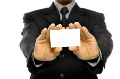 Business Man Holding Name Card. Isolated over white background. You can put your message on the card Stock Image