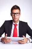 Business man holding a new pad Royalty Free Stock Image