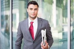 Business man holding a newspaper Royalty Free Stock Photography