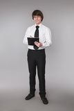 Business man holding notebook. Confident handsome student smilin Stock Images