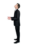 Business man holding nothing Royalty Free Stock Photography