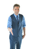 Business man holding out hand for a hand shake Royalty Free Stock Images