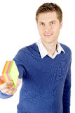 Business man holding a pack of post its. Stock Photo