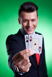 Business man holding a pair of  aces Stock Photography