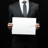 Business man holding a paper Stock Images