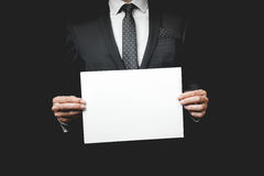 Business man holding a paper Stock Photos