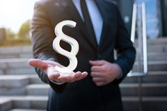 Business man holding paragraph sign in his hand royalty free stock image