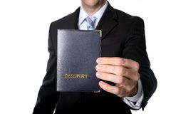 Business man holding passport Stock Image