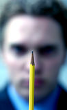 Business man holding pencil Royalty Free Stock Photography