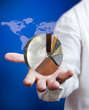 Business man holding pie graph royalty free stock images