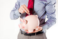 Business man holding a pig bank Stock Image