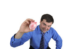 Business man holding piggy bank Stock Photos