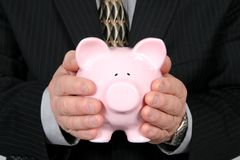Business Man Holding Piggy Bank Royalty Free Stock Photography