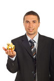 Business man holding piggy bank Stock Photo