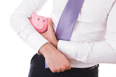 Businessman holding a piggy bank. Stock Images