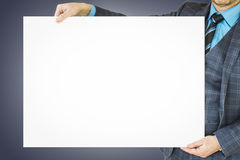 Business man holding poster with room for text and graphic. Stock Photo