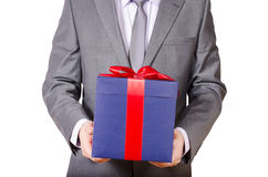 Business man holding present box Stock Photos