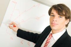 Business man holding presentation Stock Photography