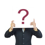Business man holding question sign stock photography