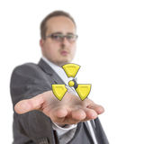 Business man holding radioactive Symbol Stock Photos