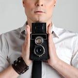 Business man holding rarity old photographic camera closeup. Royalty Free Stock Photos