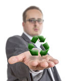 Business man holding recycling Symbol. Business man reaches out his arm with a XXX symbol floating over his hand. Isolated on White Background Royalty Free Stock Photography