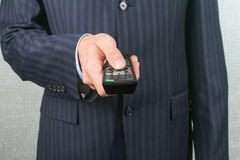 Business Man Holding a Remote Stock Photo