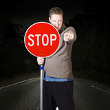 Business man holding road stop sign Royalty Free Stock Photography