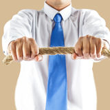 Business man holding rope Stock Photography