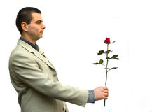 Business man holding rose Stock Photos