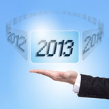 Business man holding screen with 2013 Royalty Free Stock Photography