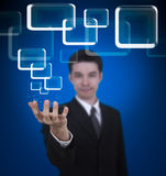 Business man holding screen Stock Photo