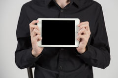 Business man holding and shows touch screen tablet pc Stock Photography