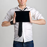 Business man holding and shows touch screen tablet pc with blank screen Stock Photos